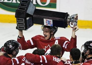 Dougie Hamilton hoisted the trophy after Canada won a four-game junior challenge with Russia in August.